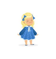 Beautiful blonde little girl posing in blue dress vector