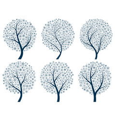 abstract silhouettes of trees with snowflakes vector image