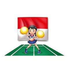 A cheerleader in front of the Indonesian Flag vector image