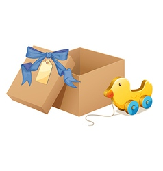 A wooden duck beside a brown box vector image