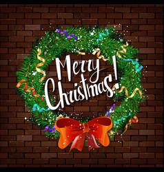christmas wreath on the brick wall vector image