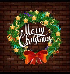 Christmas wreath on the brick wall vector
