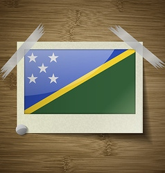 Flags Solomon Islands at frame on wooden texture vector image