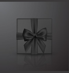 realistic black gift box with black bow and vector image