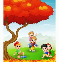 Happy children playing in t vector