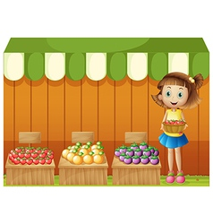 A girl selling different fruits vector image