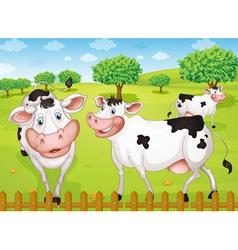 Cows grazing in farm vector