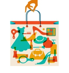 Woman hand holding hopping bag with woman cloth vector