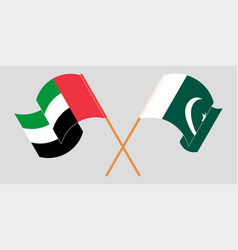 Crossed and waving flags pakistan vector