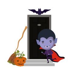 Cute little boy with dracula costume in house door vector