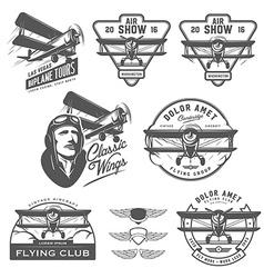 Set of vintage biplane emblems design elements vector image vector image