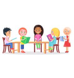 schoolchildren sitting at desk and reading books vector image