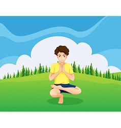 A handsome young boy doing yoga in the hill vector