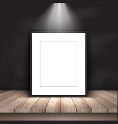 blank picture leaning against chalkboard vector image vector image