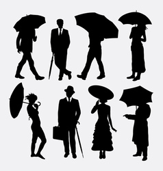 People with umbrella silhouettes vector image
