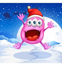 A happy pink monster jumping with a red hat vector image