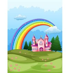 A castle at the hilltop with a rainbow in the sky vector image