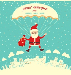 Santa claus on parachute flying in winter blue sky vector