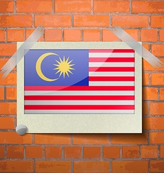 Flags malaysia scotch taped to a red brick wall vector