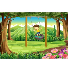 A young boy playing with the tire swing vector