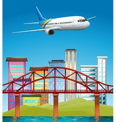 Airplane flying over buildings vector image