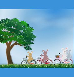 Cute rabbits the gang happy in the meadow vector