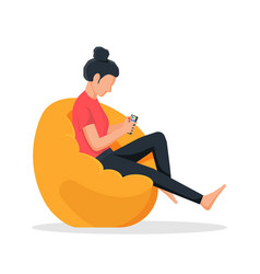 Girl sitting on bean bag chair with smartphone vector