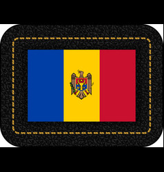 Flag of moldova icon on black leather backdrop vector