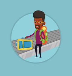 Man picking up suitcase on luggage conveyor belt vector