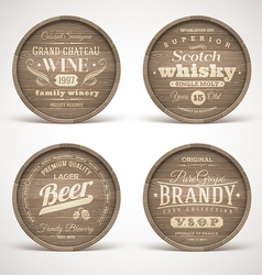 Wooden casks with alcohol drinks emblems vector image