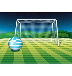 A soccer ball at the field with the flag of Greece vector image
