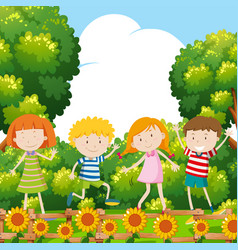 four kids in sunflower garden vector image