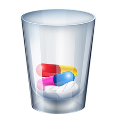 A measuring glass with capsules and tablets vector