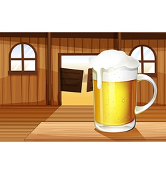 A table with a mug full of beer vector