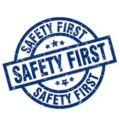 Safety first blue round grunge stamp vector