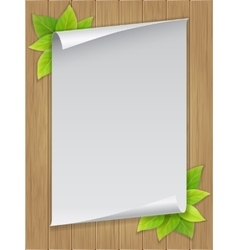 Paper sheet and green leaves on wooden background vector