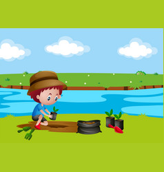 boy planting tree by the river vector image