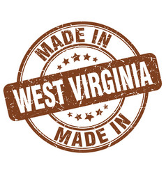 Made in west virginia brown grunge round stamp vector