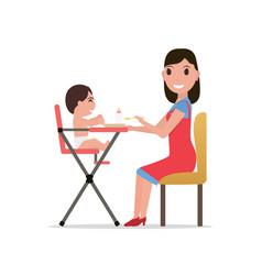 cartoon mother feeding baby vector image vector image