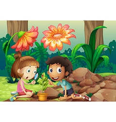 A girl and a boy looking at plant with a vector