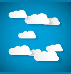 Clouds Cut From Paper on Blue Sky Background vector image vector image