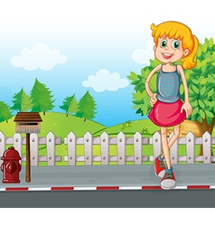 A tall young girl at street near mailbox vector