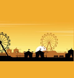 Silhouette of amusement park with orange sky vector