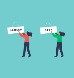 woman hanging closed and open shop sign vector image