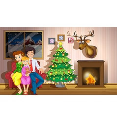 A family inside the room with a christmas tree vector image