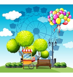 Park with popcorn vendor and balloons vector