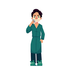 Young man in bathrobe and pajamas shaving beard vector