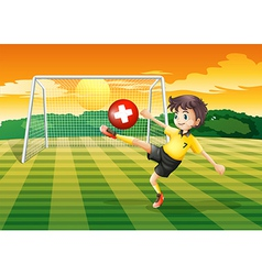 A girl at the field kicking the ball with the flag vector