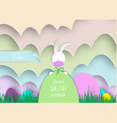 easter eggs and white bunny rabbit wearing a mask vector image