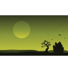 Silhouette of Halloween house and bat vector